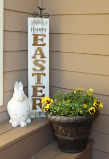 """Happy Easter"" sign placed with bunny figure and planter"