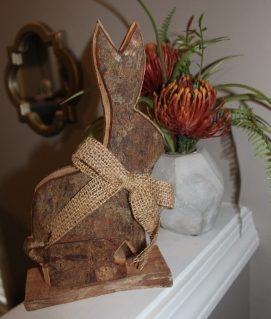 wooden bunny Easter decor place with orange floral arrangement
