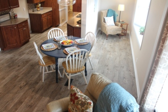 Kitchen and reading nook staged with same color scheme throughout