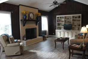 Staged family room with painted fireplace and built-ins