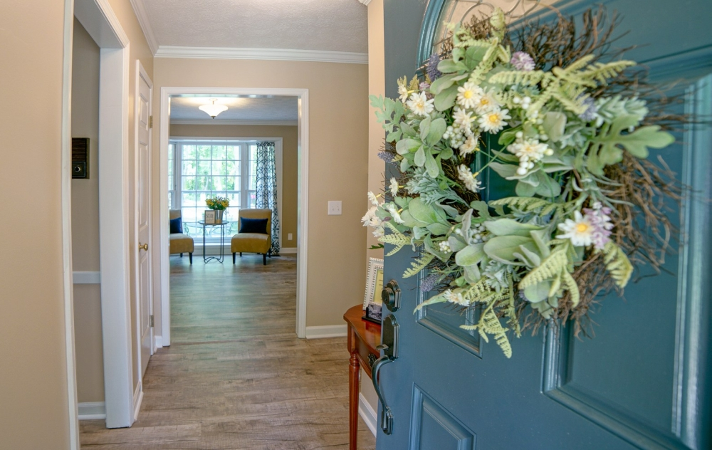 Entryway of staged home complete with inviting sitting area