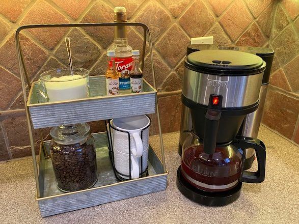 coffee pot and coffee needs on tiered serving tray